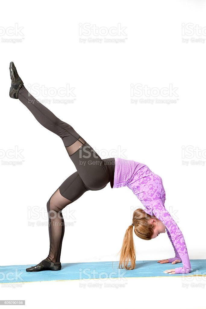 sport exercise, backbend, One-legged Upward Bow (Wheel) Posture stock photo