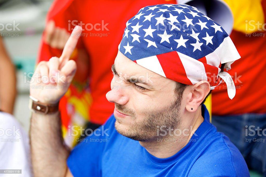 Sport fan does an obscene gesture stock photo