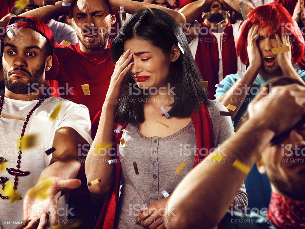 Sport fans: A girl in despair stock photo