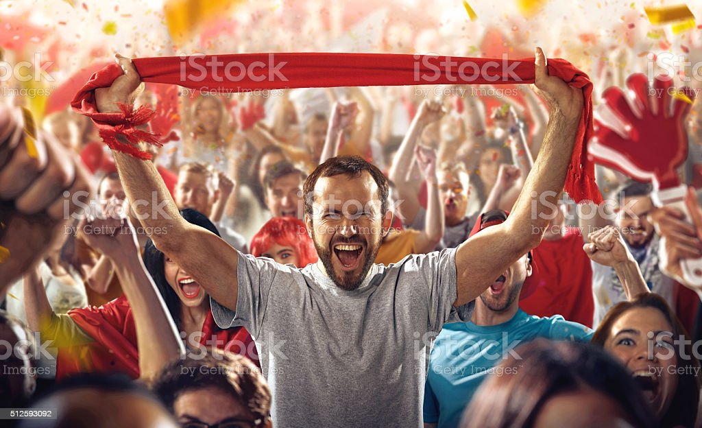 Sport fans: A man with scarf stock photo