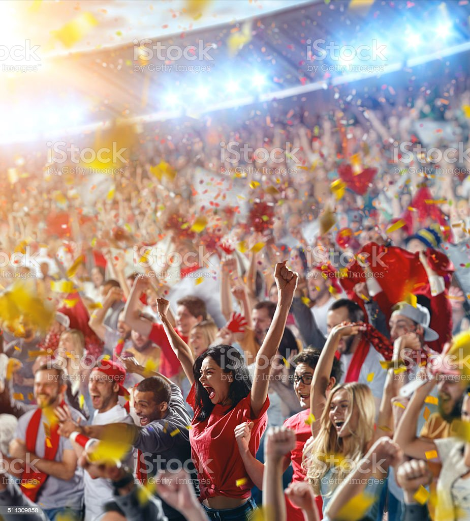 Sport fans: Girl puts hands in the air stock photo
