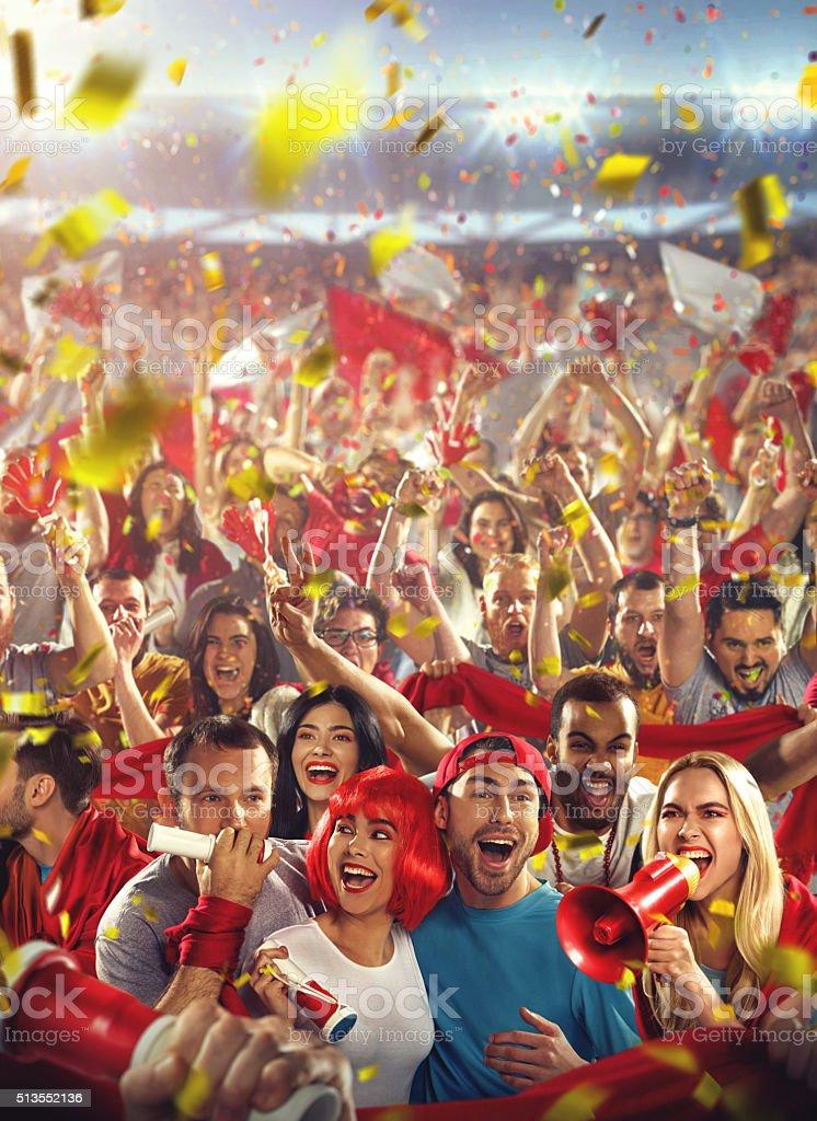 Sport fans: Happy cheering crowd stock photo