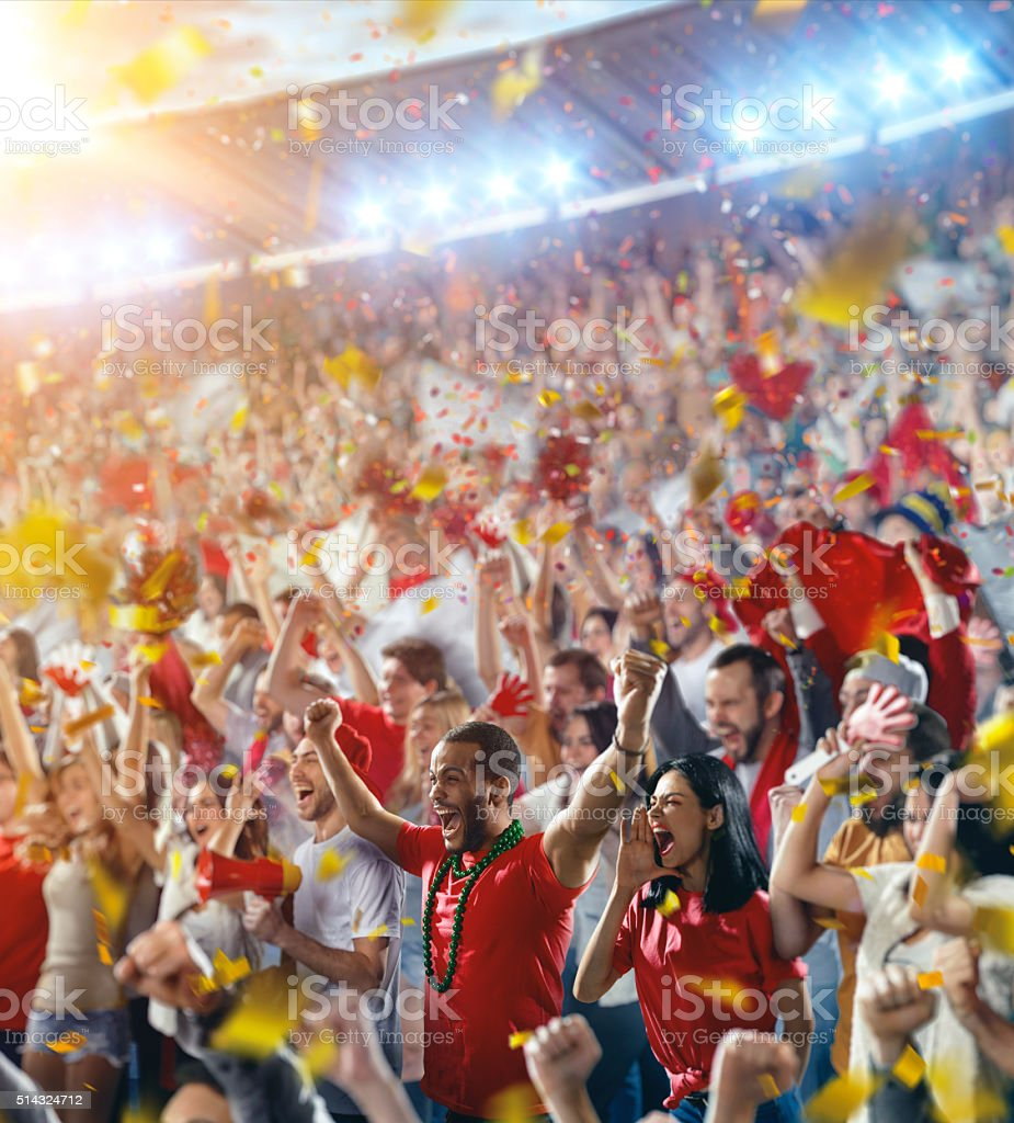 Sport fans: Happy cheering crowd stock photo