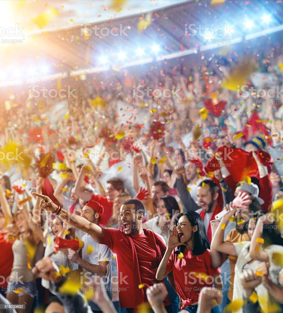 Sport fans: Happy cheering friends stock photo