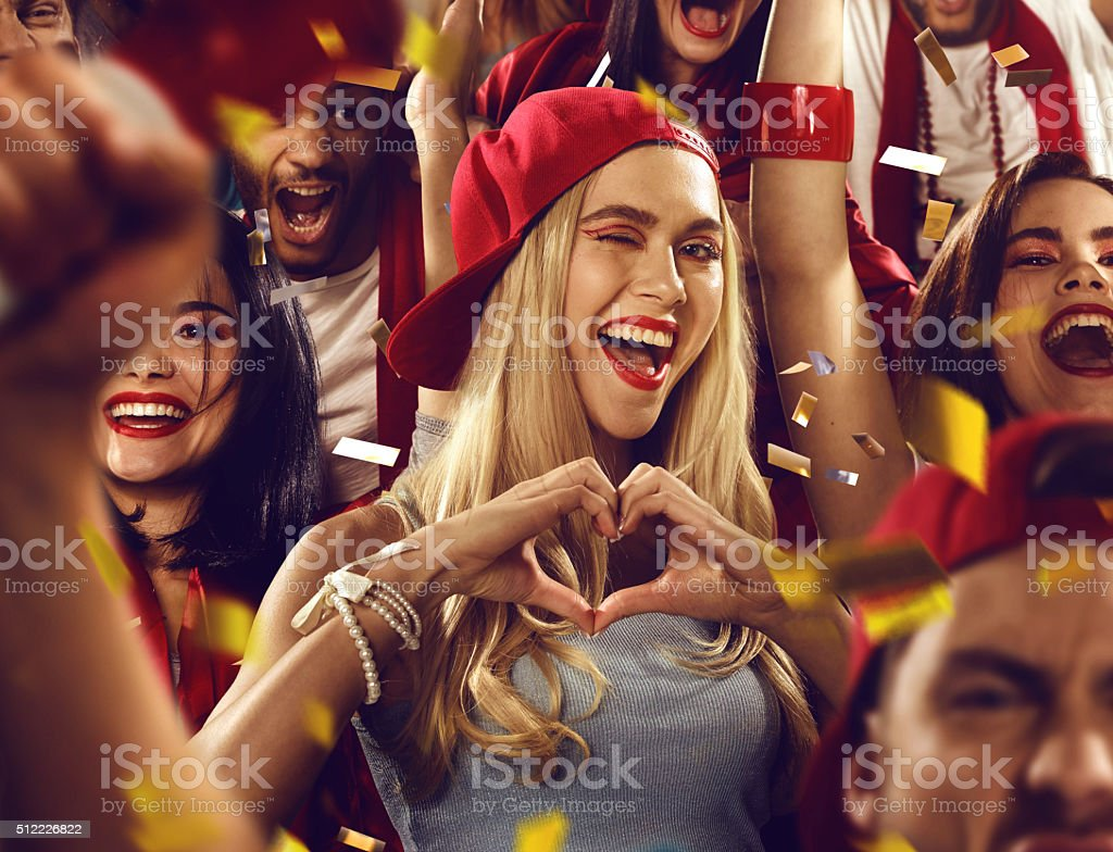 Sport fans: Heart symbol made with hands stock photo