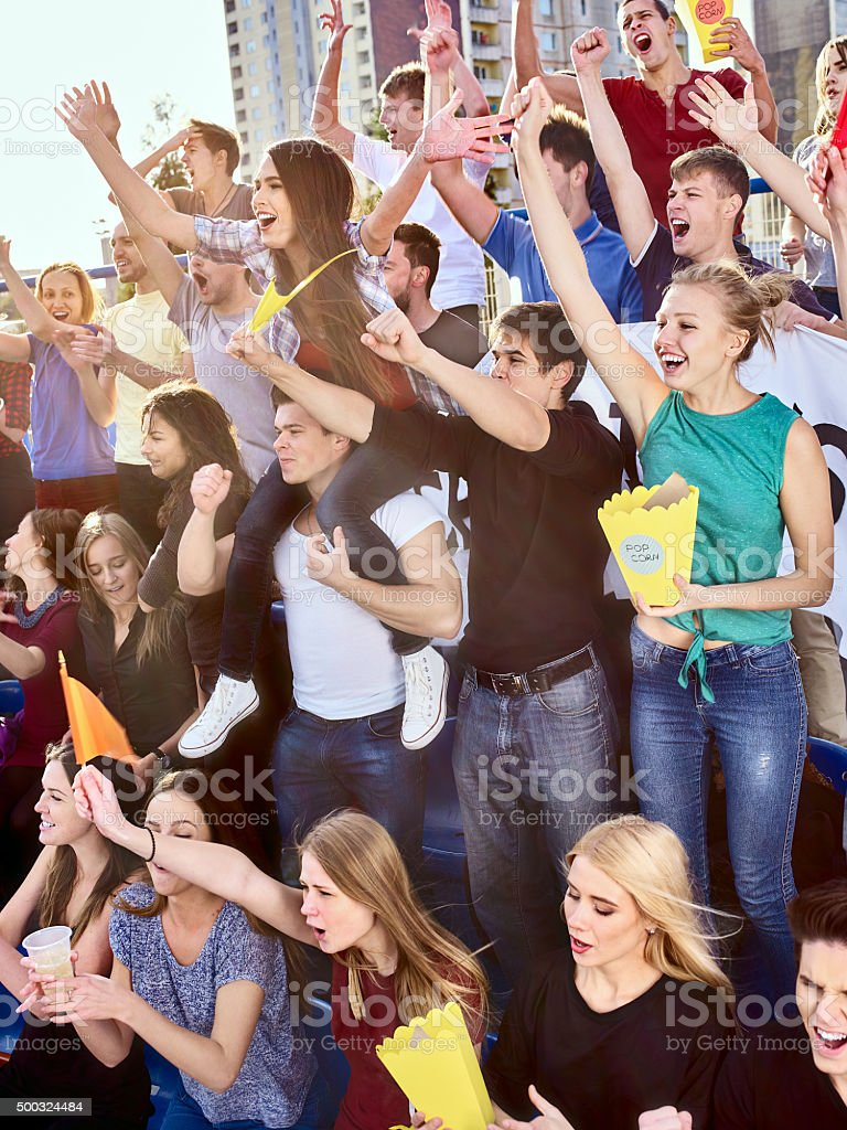 Sport fans holding champion banner on tribunes stock photo