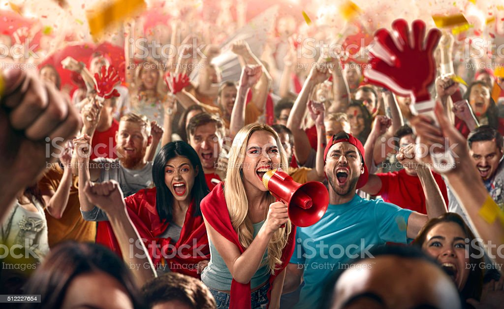 Sport fans: Shouting in megaphone stock photo
