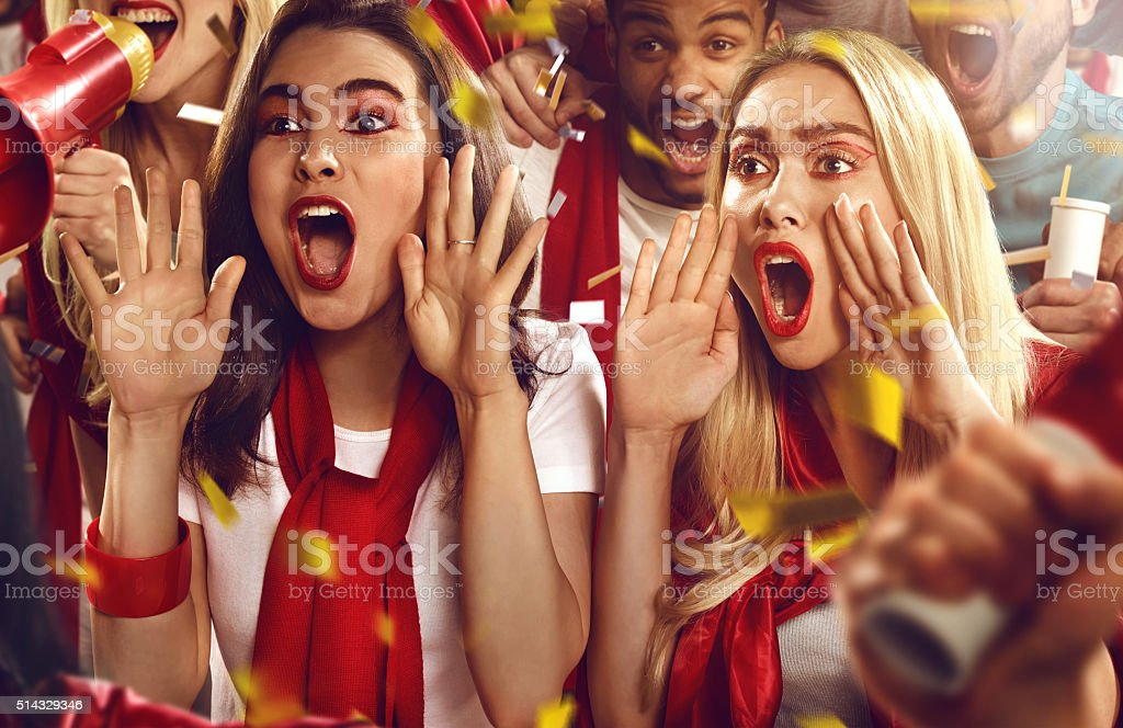 Sport fans: Two girls shouting stock photo