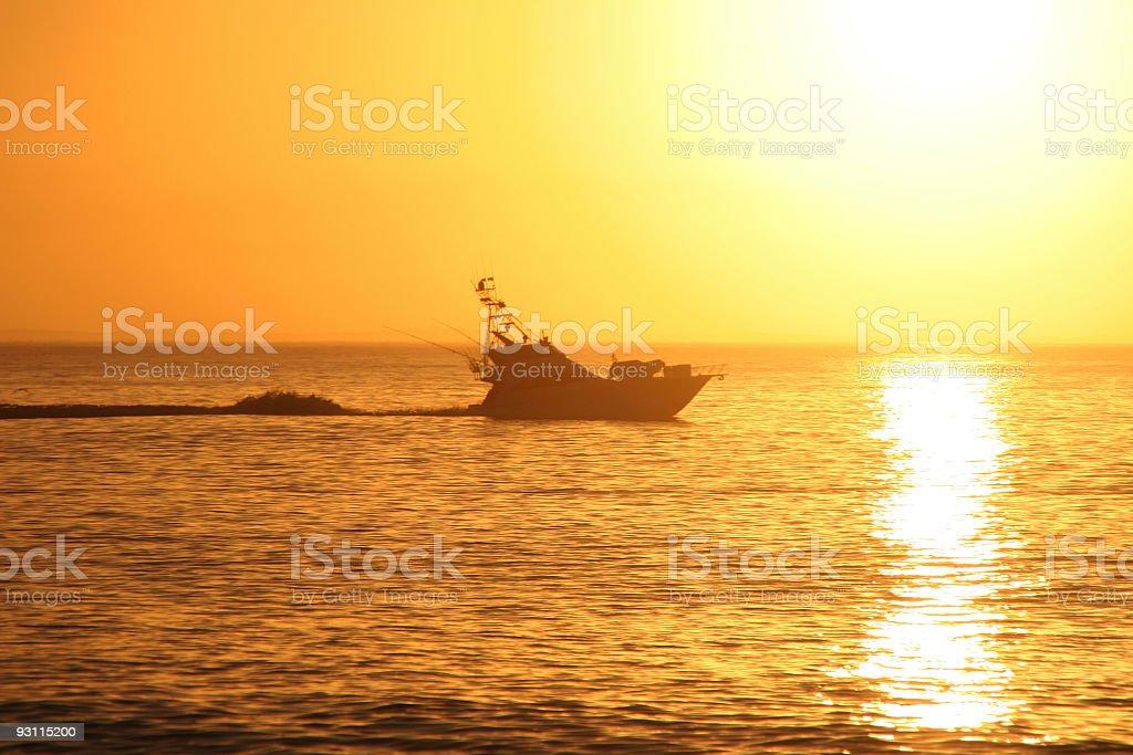 Sport Fishing Boat at Sunrise royalty-free stock photo