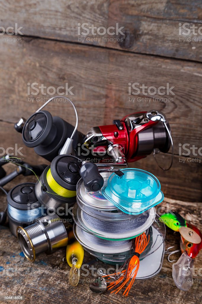 sport fishing tackles, baits, reels, spool with line stock photo