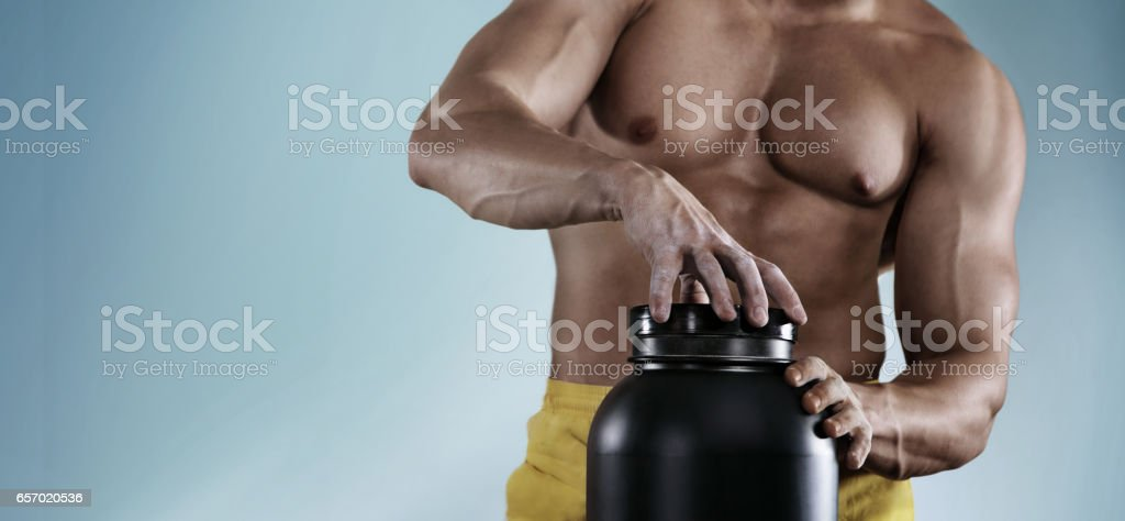 Sport. Fitness. Healthy lifestyle and people concept - close up of athlete man with jar and bottle protein shake. Isolated stock photo