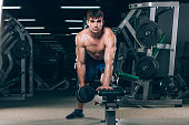 sport, fitness, lifestyle and people concept - flexing muscles with