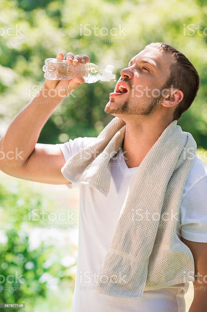 Sport fitness man. Young athletic man cooling himself stock photo