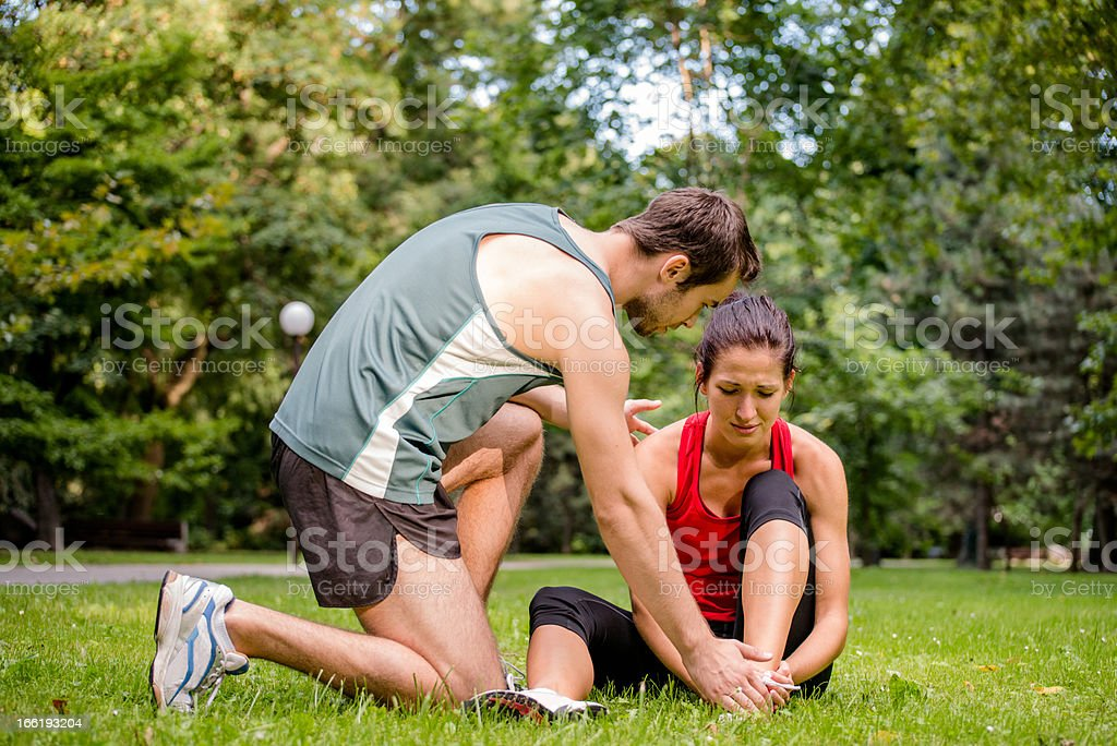 Sport injury - helping hand royalty-free stock photo