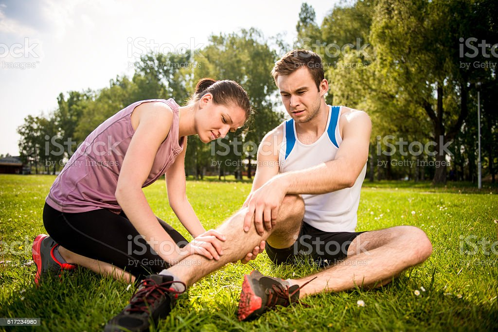Sport Injury - helping hand stock photo