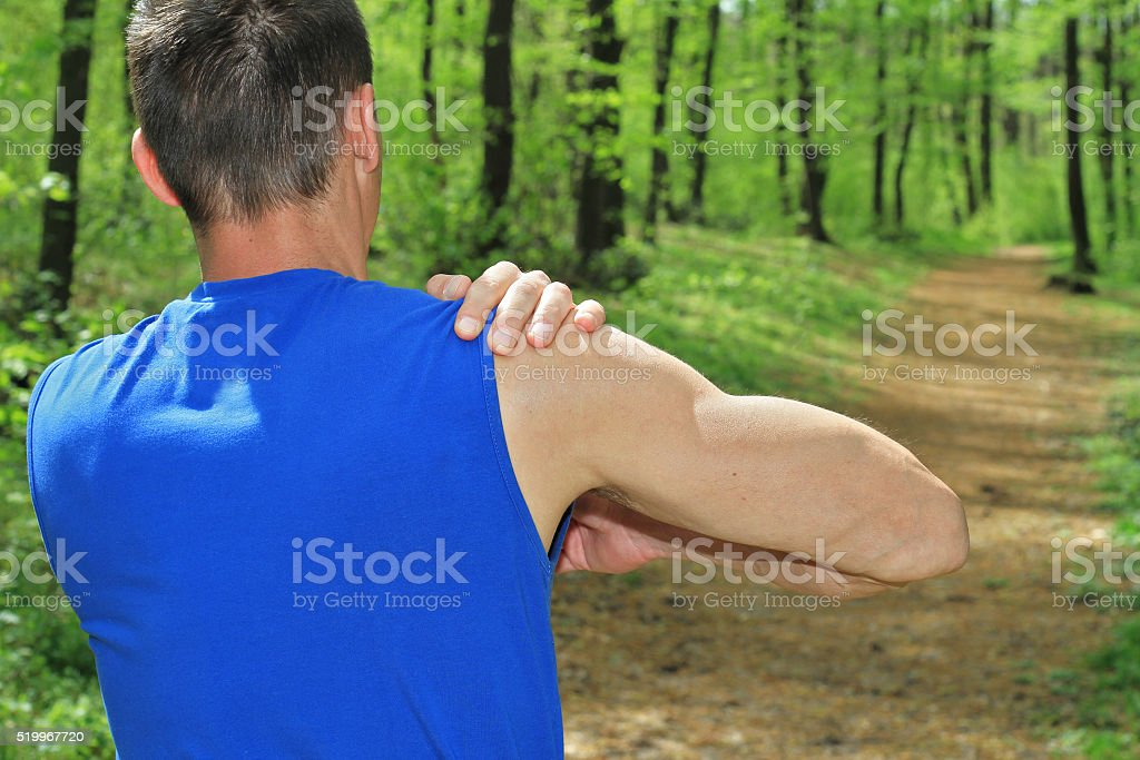Sport injury, Man with shoulder pain stock photo