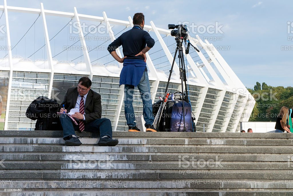 Sport journalists prepared before football match stock photo