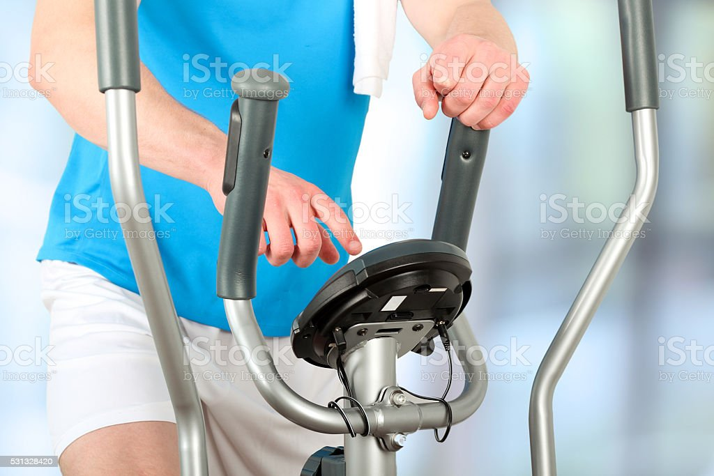 Sport man doing healthy Fitness with a Exercise Machine stock photo