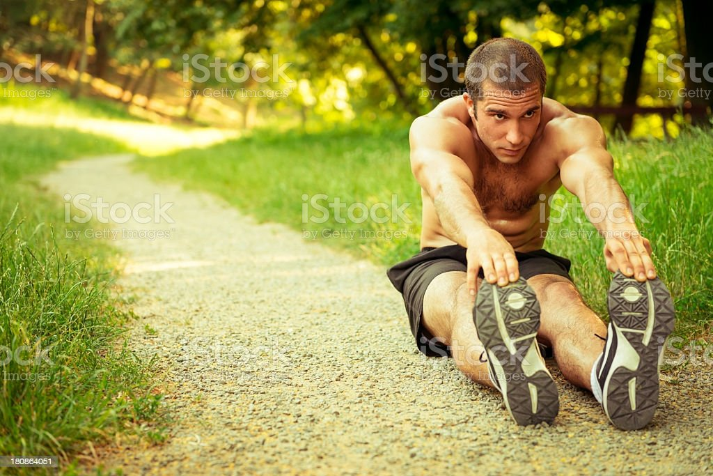 Sport man stretching at the park royalty-free stock photo