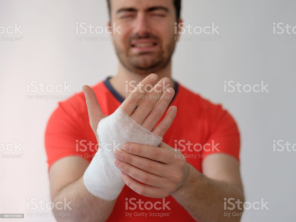 sport man with bandages medication on his hand stock photo