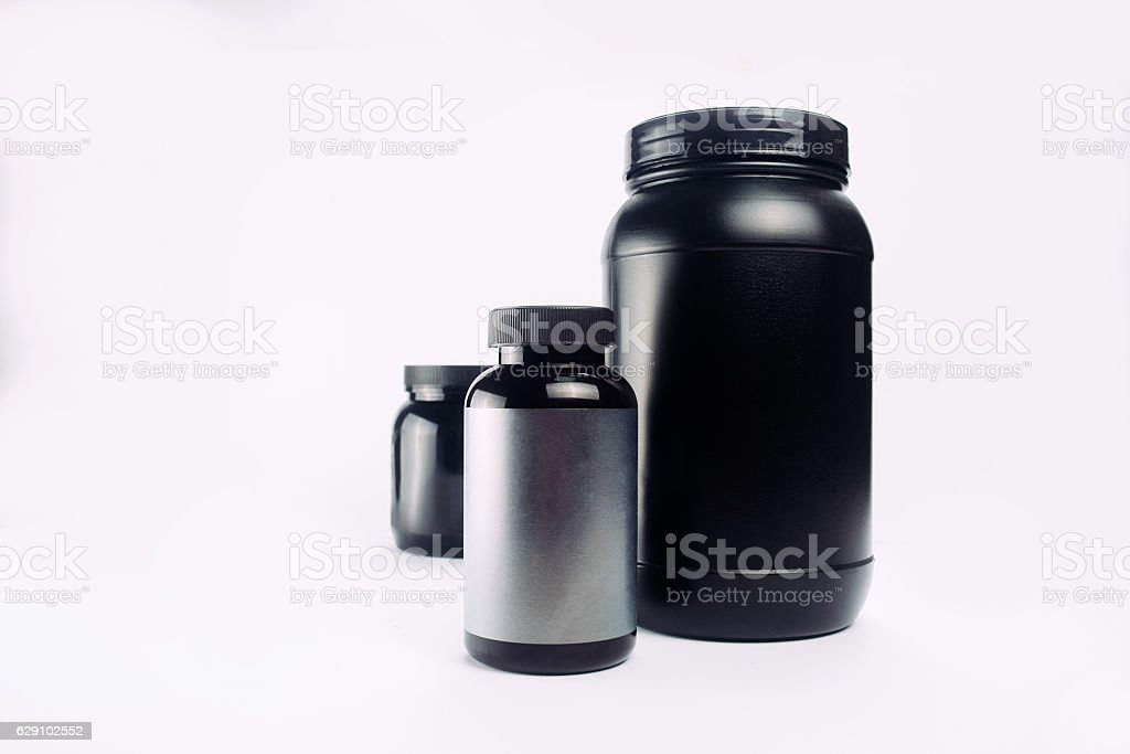 Sport Nutrition, Whey Protein and Gainer. Black Plastic Jars iso stock photo