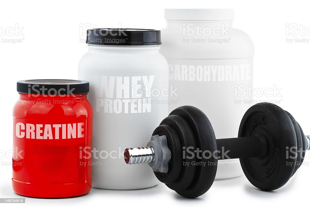 Sport Nutritional Supplement containers with dumbell stock photo