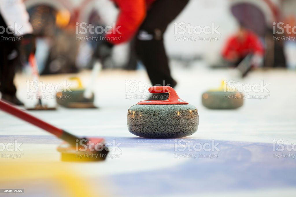 Sport of curling being played on a field stock photo