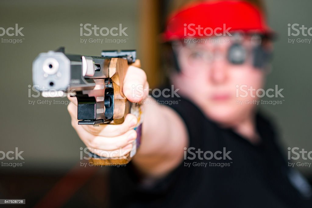 Sport pistol shooting stock photo