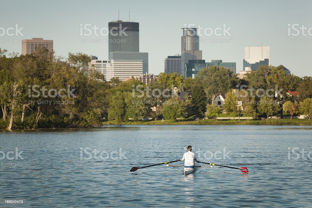 Sport Sculling with Minneapolis Downtown Skyline in Background Hz stock photo