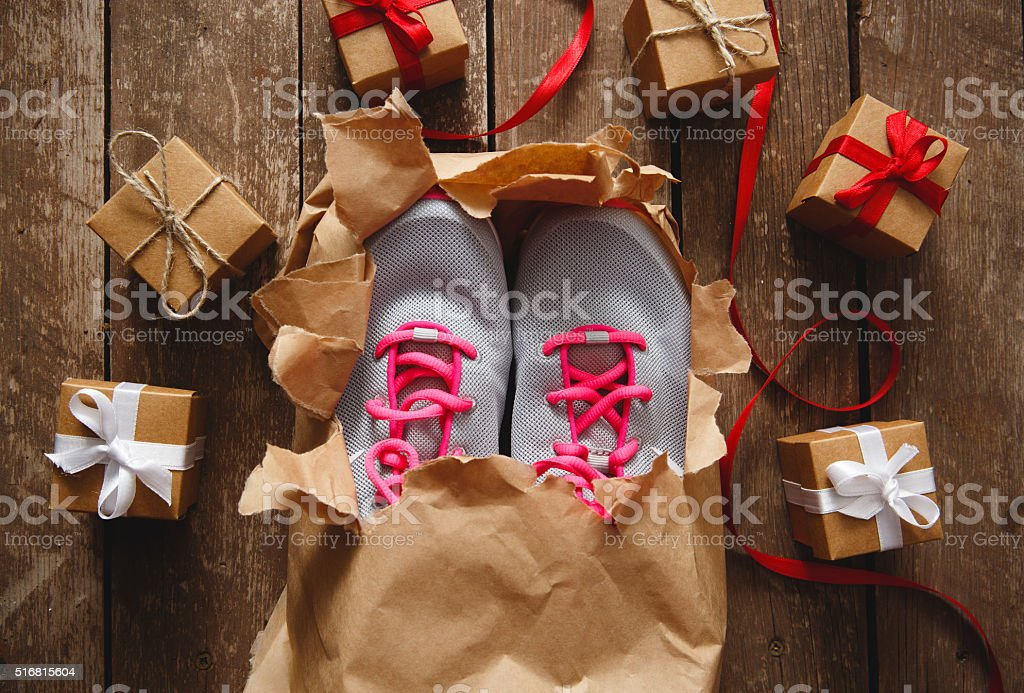 Sport shoe gift boxes on wood stock photo