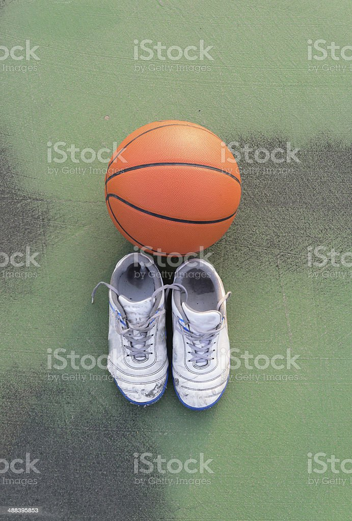Sport shoes and basket ball stock photo