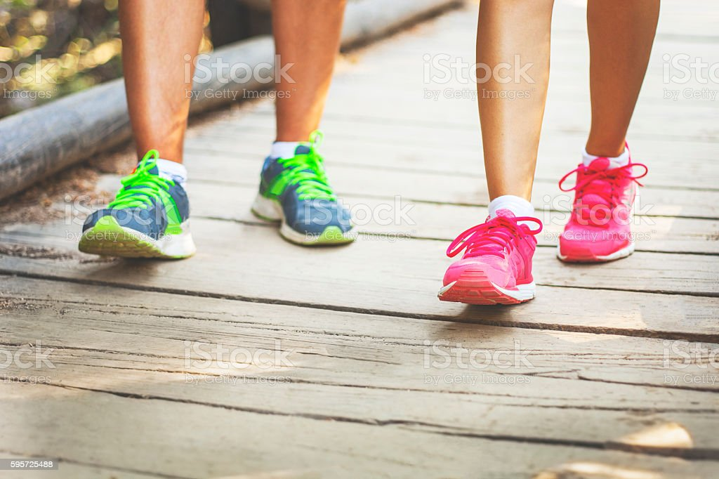 Sport shoes on a wooden bridge. stock photo