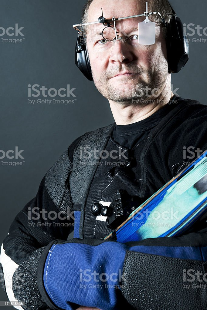 A sport shooter using a 22 caliber rifle royalty-free stock photo