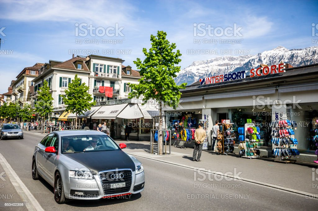 Sport shop and tourists on the streets of Interlaken, Switzerland stock photo