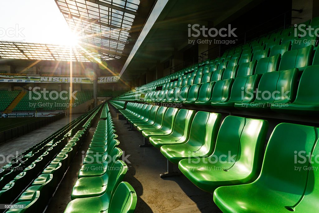 Sport stadium Plastic chairs in a row stock photo