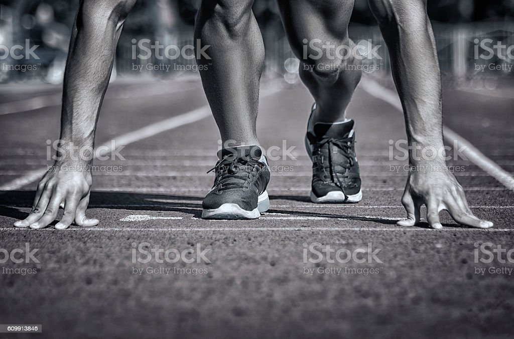 Sport. Unrecognizable runner on the starting stock photo