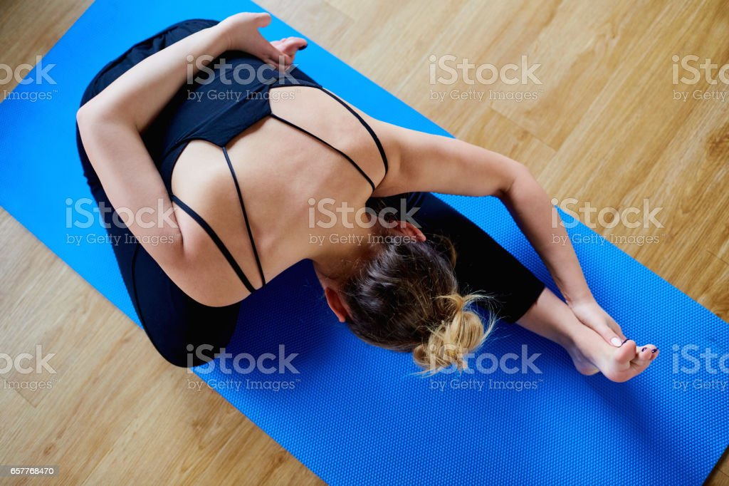 Sport woman doing yoga in the gym stock photo