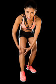 sport woman holding injured knee suffering pain in ligaments