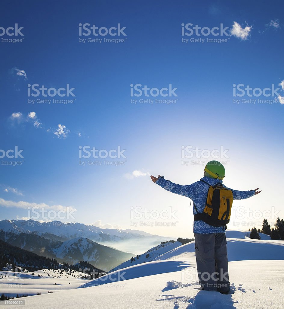 Sport woman in snowy mountains royalty-free stock photo