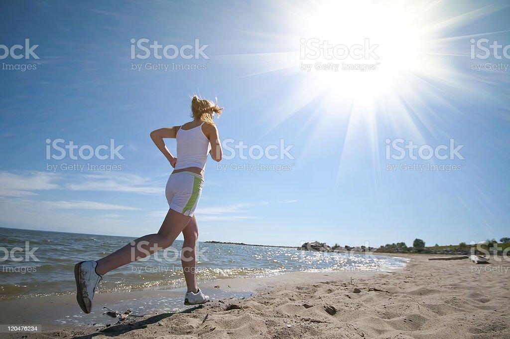Sport woman running on beach royalty-free stock photo