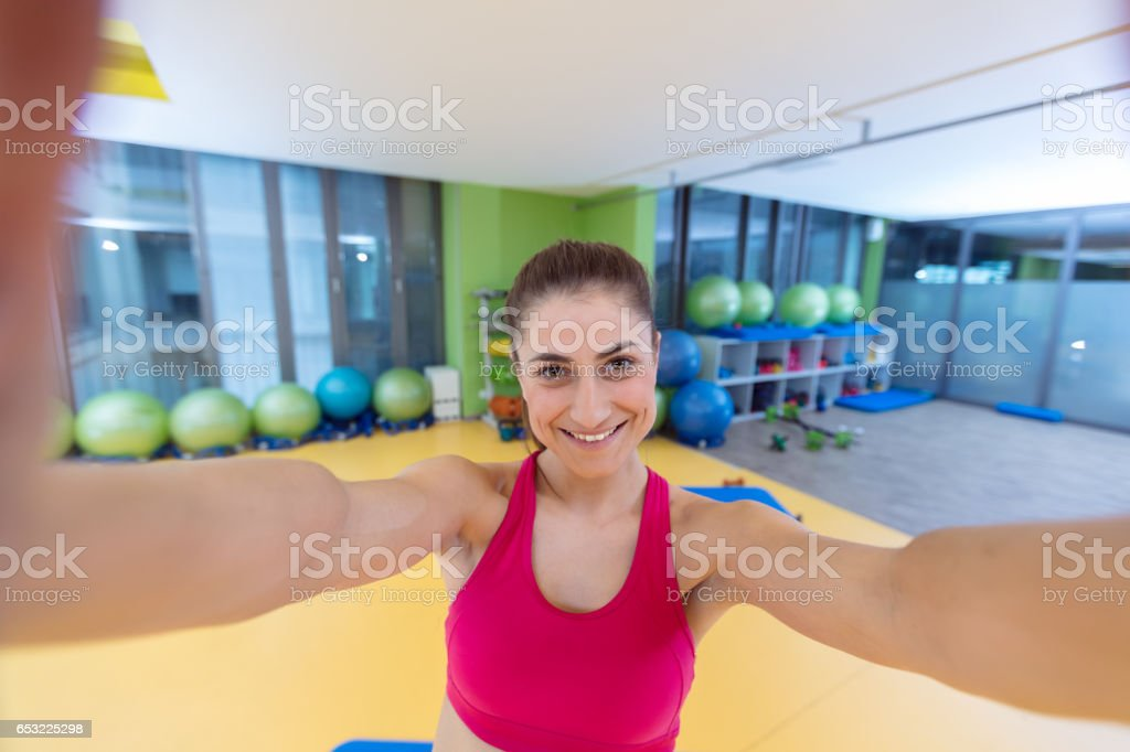 sport woman smile at camera self picture at gym, young girl picture...