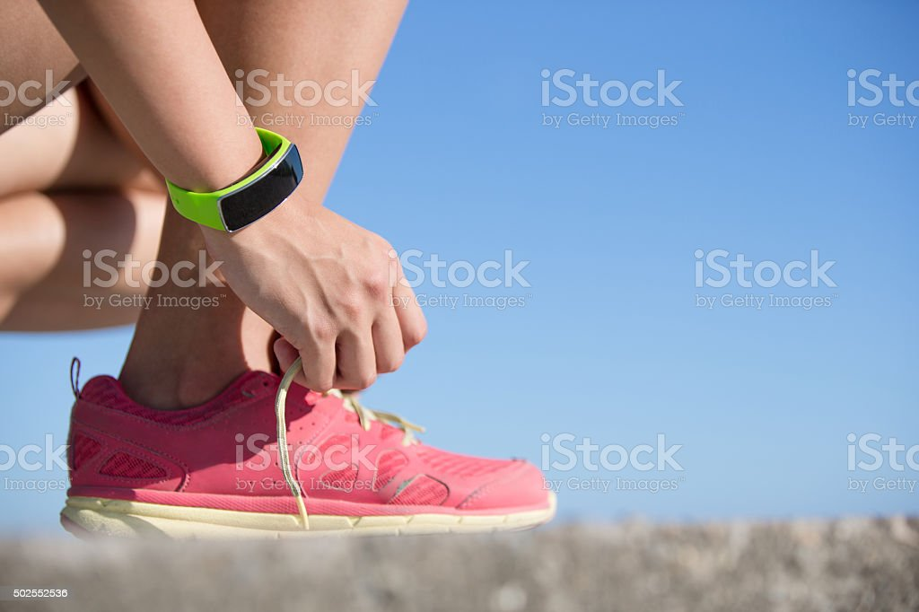 sport woman wearing smart watch stock photo