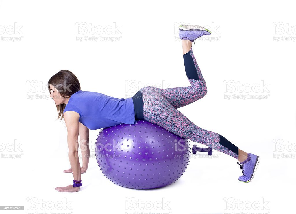 Sport woman with a pilates ball and dumbbells royalty-free stock photo