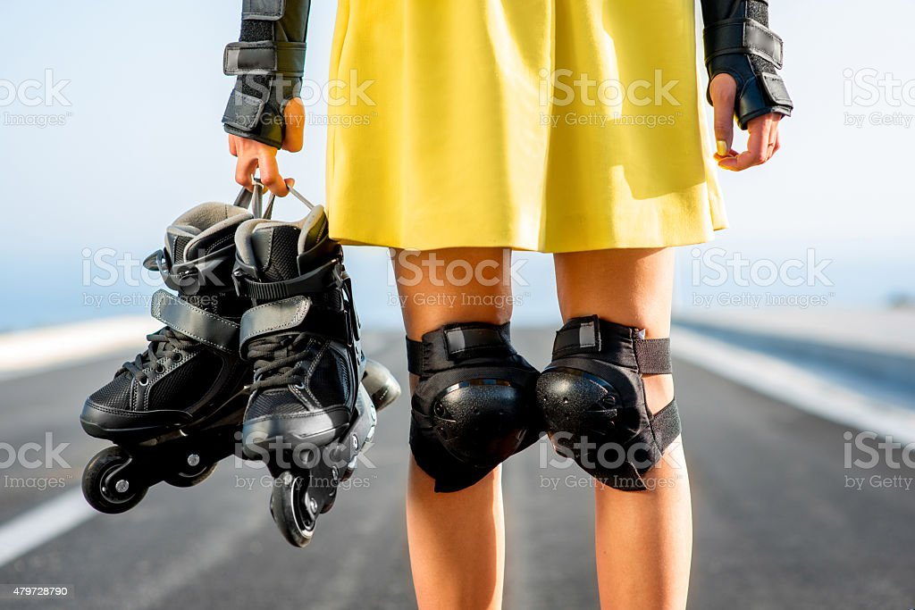 Sport woman with rollers on the highway stock photo