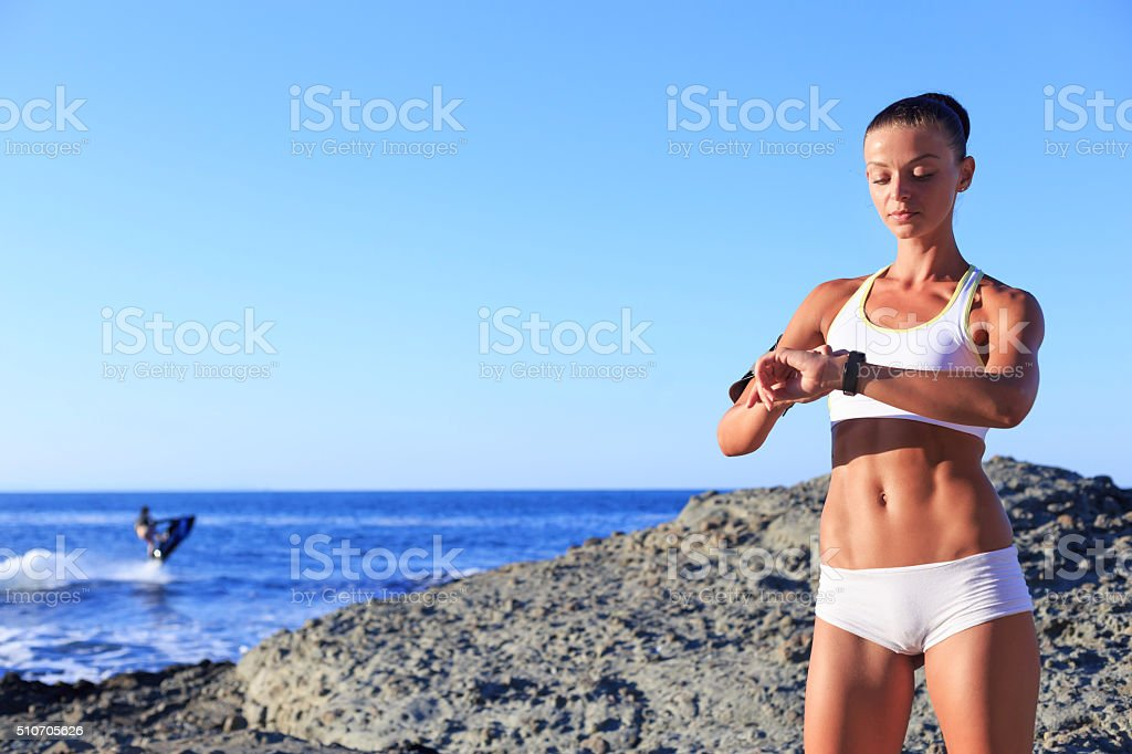Sportif Woman looking her pulse stock photo