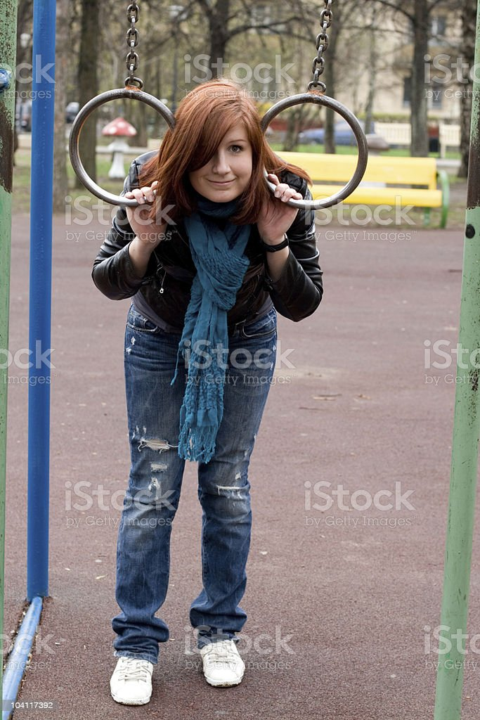 Sportive girl hanging on the rings royalty-free stock photo