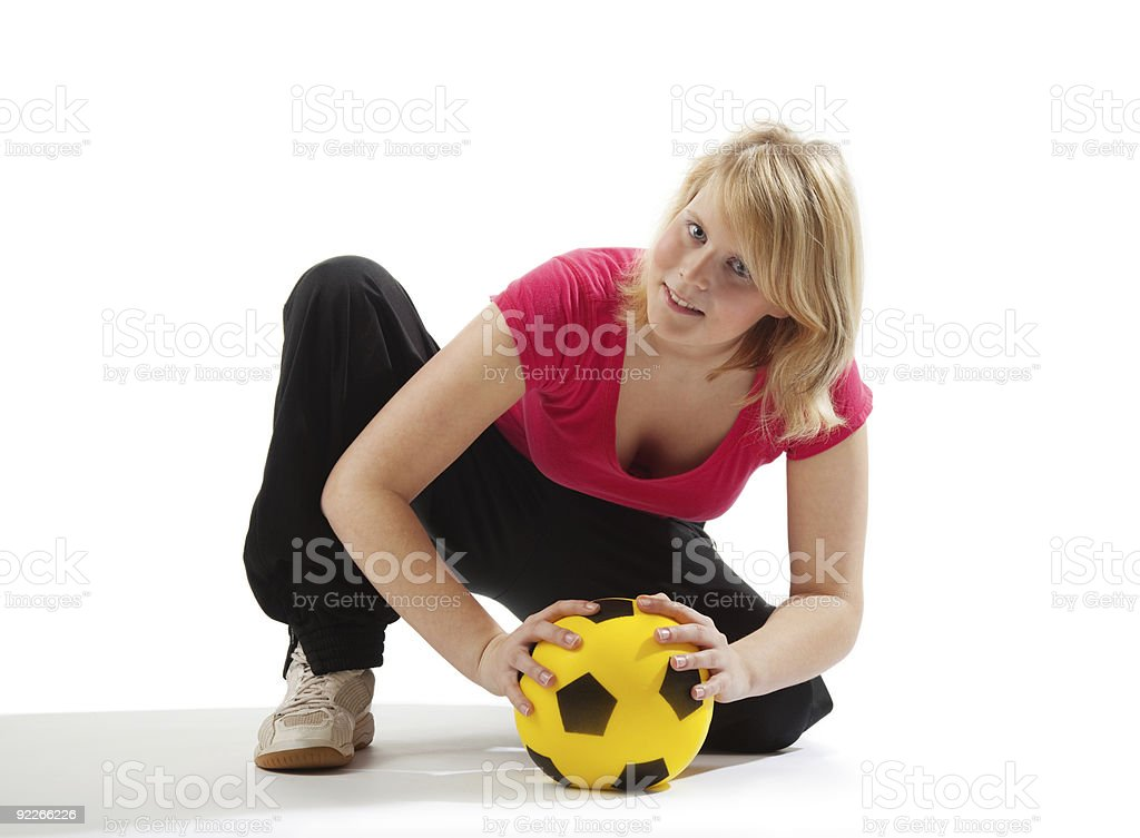 Sportive girl with yellow ball royalty-free stock photo