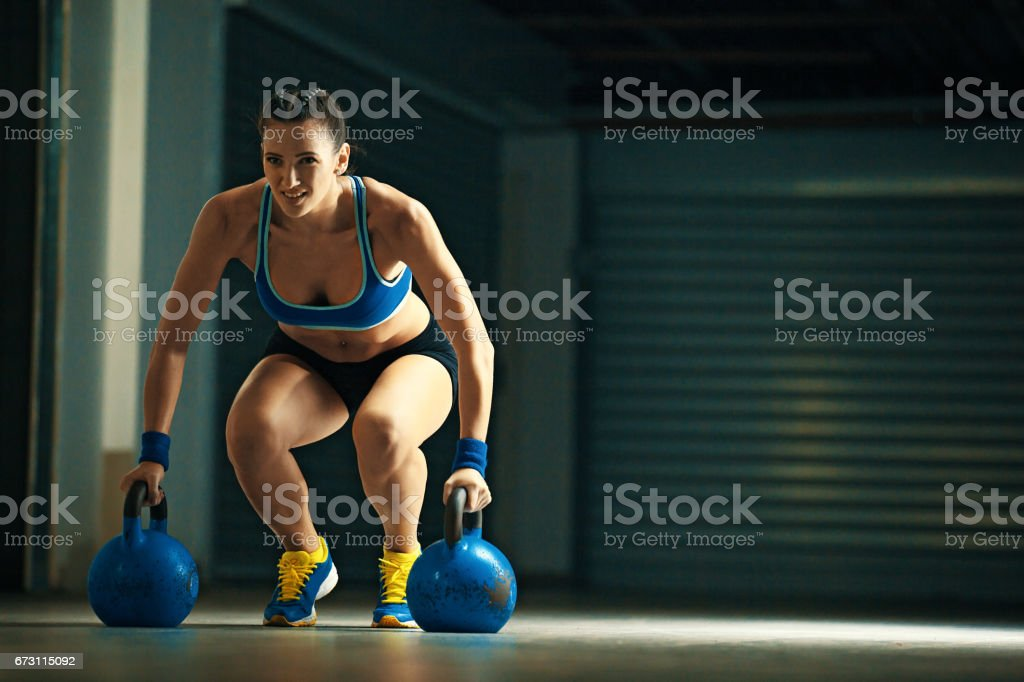 Sportive Young Woman Exercising in the Gym stock photo