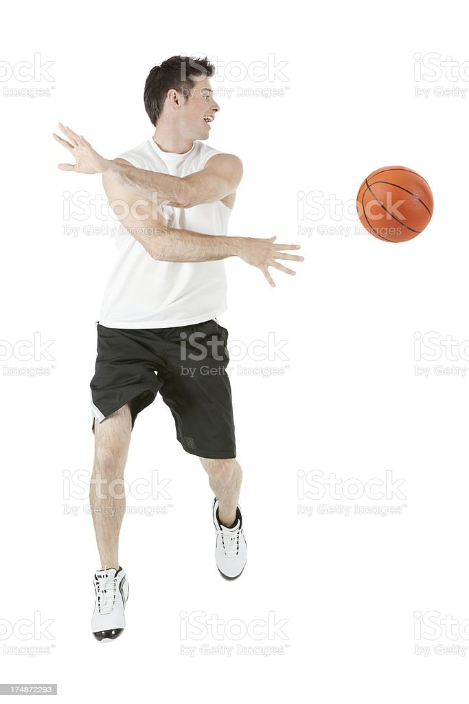 Sportman playing with basketball royalty-free stock photo