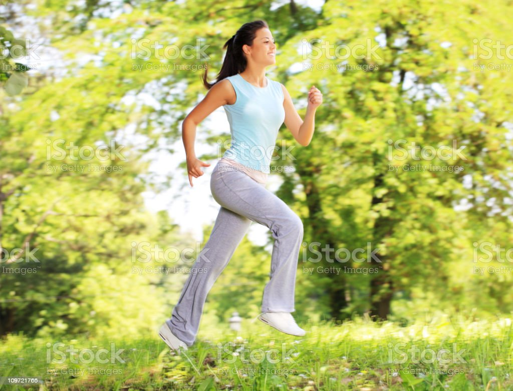 Sports active girl running in the park. royalty-free stock photo